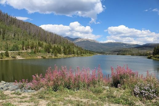Photo of a lake and surrounding folliage and mountains at State Forest State Park in Colorado.