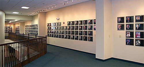 A picture of a wall at the RV/MH Hall of Fame covered in plaques