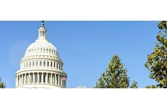A picture of the top of the U.S. Capitol Building with a blue-sky background